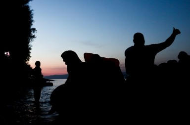 Refugees and migrants arrive on the Greek Island of Lesbos after crossing the Aegean sea from Turkey on October 15, 2015.